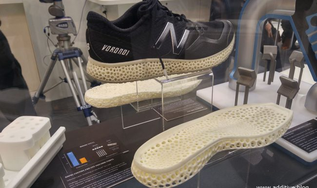 Photo showing 3D printed shoes using SLS